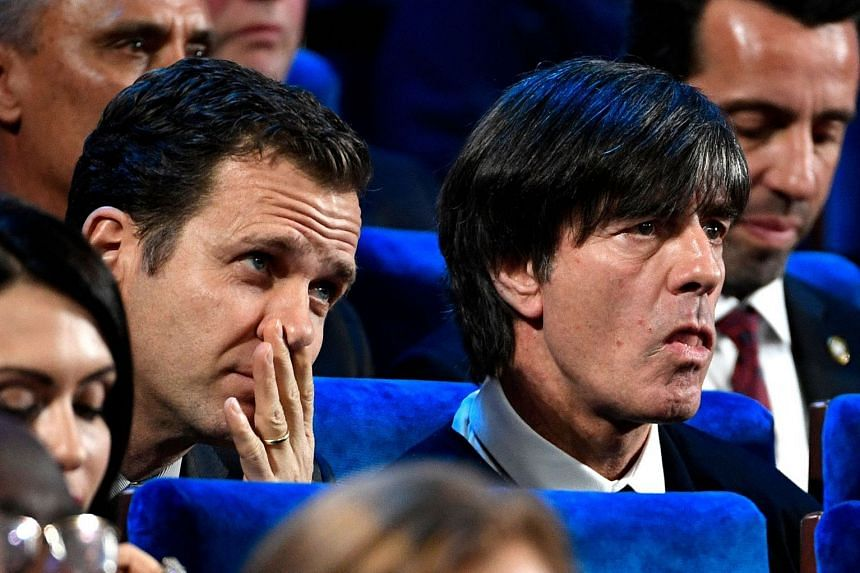 Joachim Loew (right) reacts next to team business manager Oliver Bierhoff during the draw.
