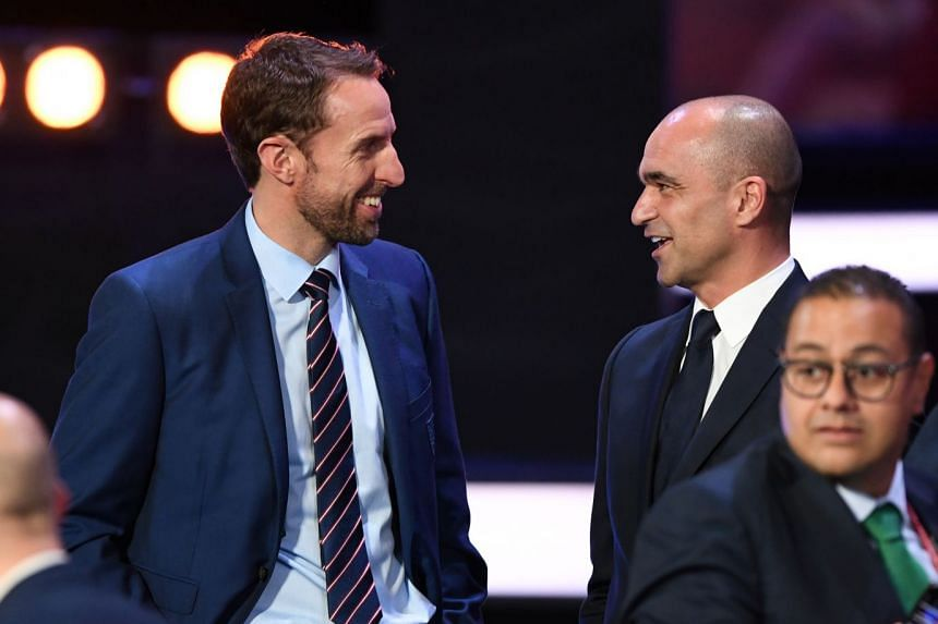 England coach Gareth Southgate (left) with Belgium coach Roberto Martinez at the end of the World Cup draw.