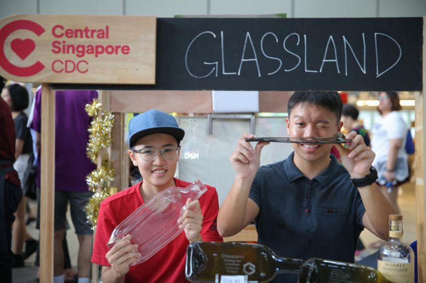 Celestia Koh (left) , 20, marketing director of Glassland, and Jonathan Lim De Ming, 21, operations director of Glassland. Glassland upcycles glass bottles by flattening and changing their shapes in kilns at high temperature.