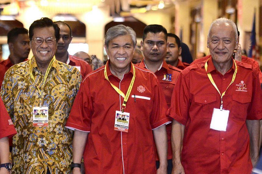Umno deputy president Datuk Seri Ahmad Zahid Hamidi (centre) arrives at the Umno Selangor Convention 2017 in Kuala Lumpur with Tan Sri Muhammad Taib (right) and Tan Sri Khalid Ibrahim on Dec 2, 2017.