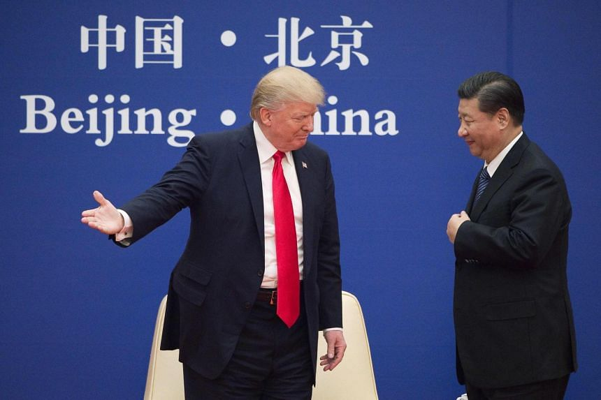 US President Donald Trump (left) and China's President Xi Jinping during a business leaders event at the Great Hall of the People in Beijing.
