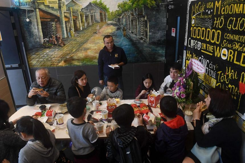 A family tries out the food in Hanoi's first McDonald's fast food chain restaurant on Dec 2, 2017.