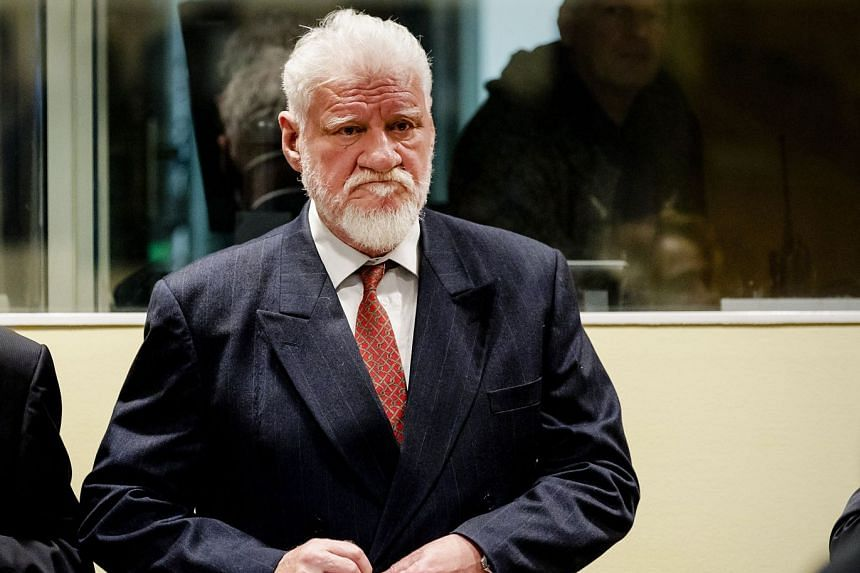 Praljak stands prior to the start of his appeal judgment on Nov 29, 2017.