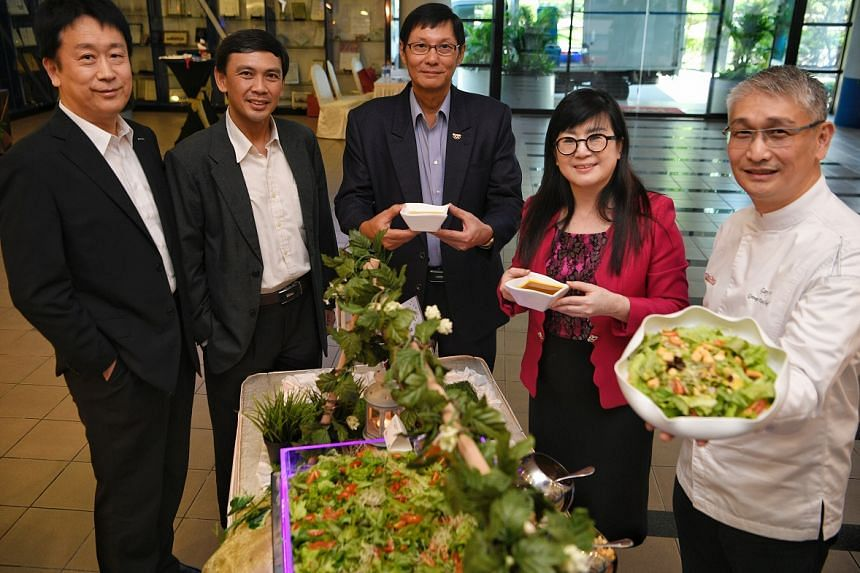 From left: Panasonic Factory Solutions Asia Pacific managing director Tatsuyoshi Ishii, Agri-Food and Veterinary Authority of Singapore CEO Lim Kok Thai, Panasonic Singapore managing director Paul Wong, Tong Chiang Group's CEO Lisa Zou and group ex