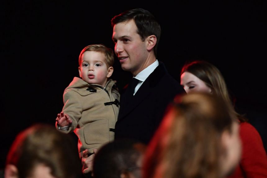 Jared Kushner and son Theodore attend the 95th annual National Christmas Tree Lighting ceremony near the White House.