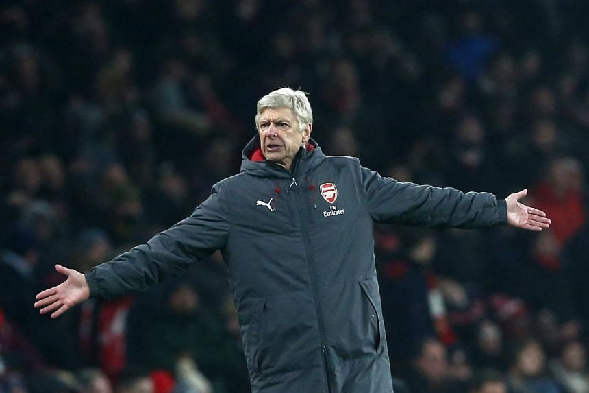 Arsene Wenger reacts during the match.