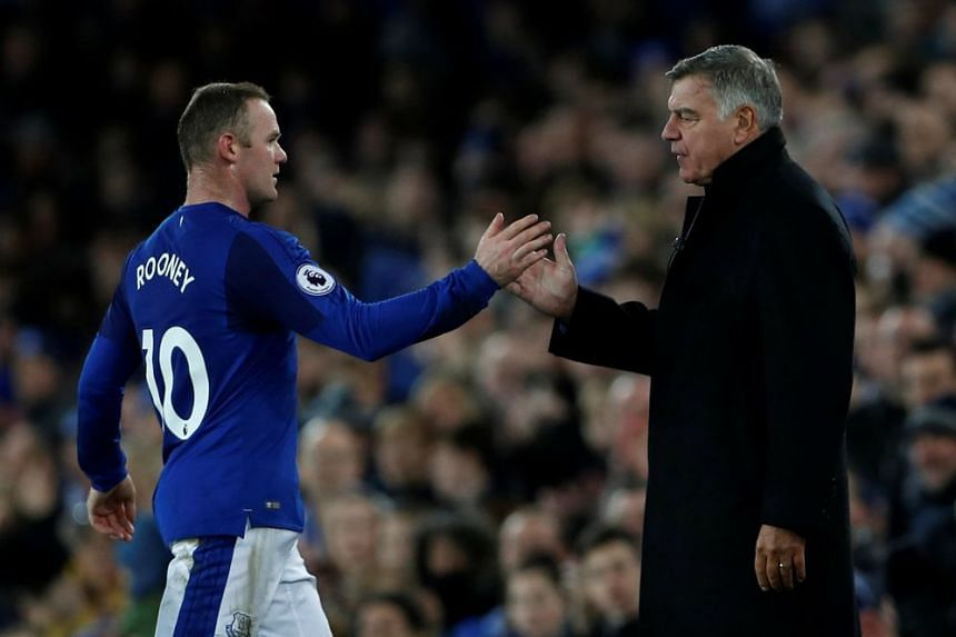 Everton's Wayne Rooney with manager Sam Allardyce as he is substituted.