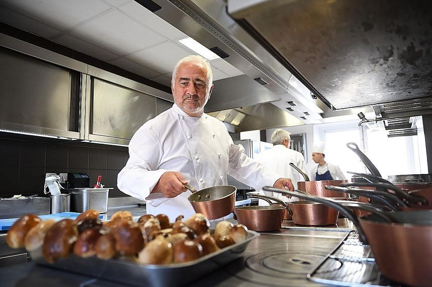 French chef Guy Savoy in the kitchen of his eponymous restaurant in Paris.