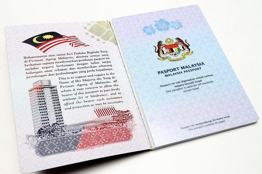The inside cover of the new Malaysian passport has songket motifs, while national landmarks are featured on other pages.
