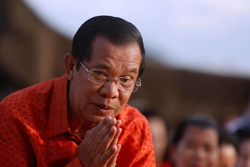 Cambodia's Prime Minister Hun Sen greets as he holds a ceremony at the Angkor Wat temple in Siem Reap province, Cambodia.
