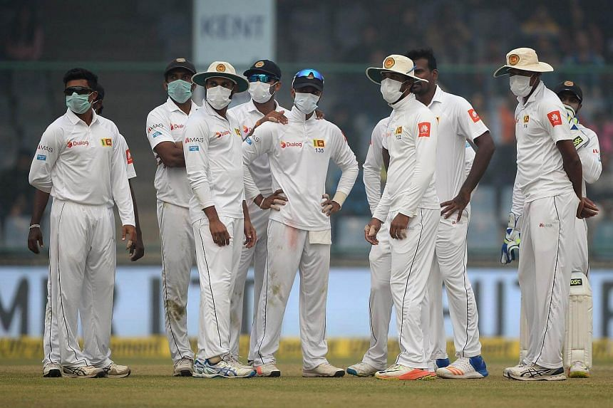 Sri Lanka cricket players wear masks in an attempt to protect themselves from air pollution during the second day of their third Test cricket match against India, on Dec 3, 2017.