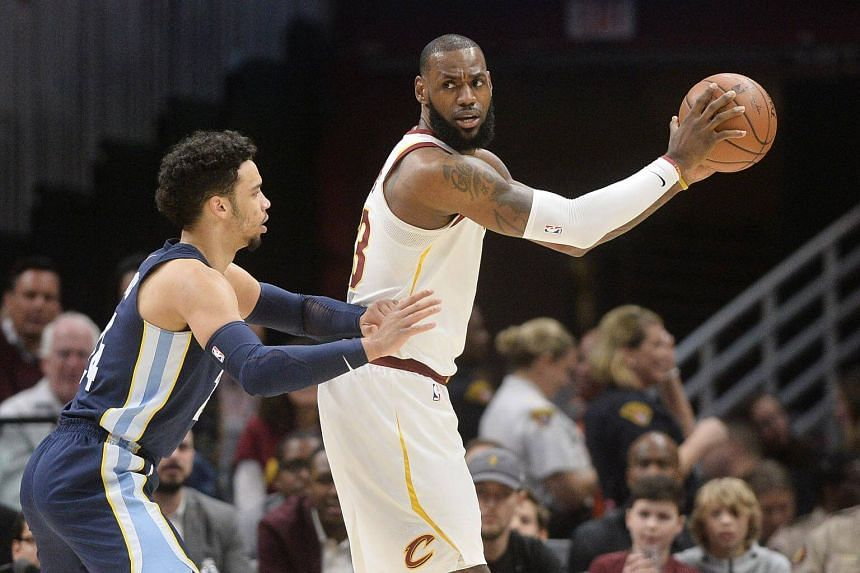 LeBron James (right) scored 15 of his 34 points in the final period as the Cavs held on for a 116-111 victory in Cleveland.