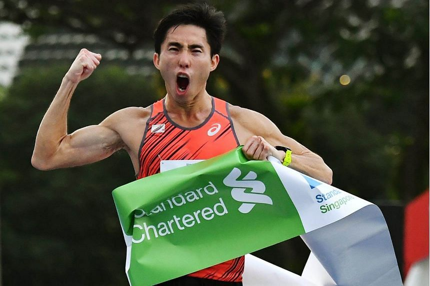 Soh Rui Yong finishing in the full category of the Standard Chartered Singapore Marathon 2017 on Dec 3, 2017.