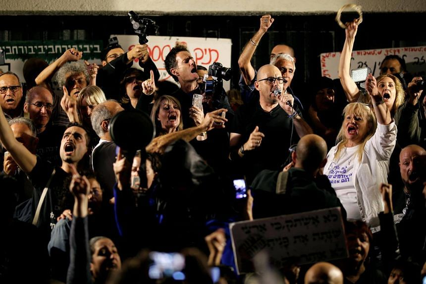 Israelis take part in a protest against corruption in Tel Aviv, Israel, on Dec 2, 2017.