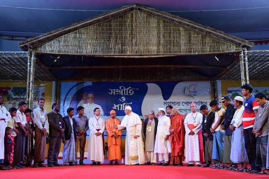 Pope Francis prays with Rohingya refugees during an Interreligious and Ecumenical meeting for peace at the garden of the Archbishop in Dhaka, on Dec 1, 2017.