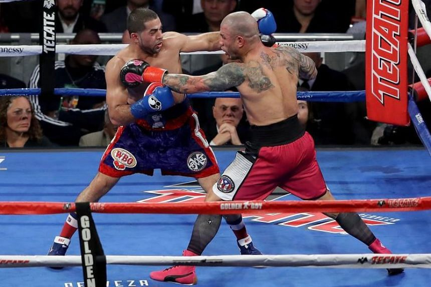 Miguel Cotto (right) and Sadaam Ali fight during their Junior Middleweight match at Madison Square Garden, on Dec 2, 2017.