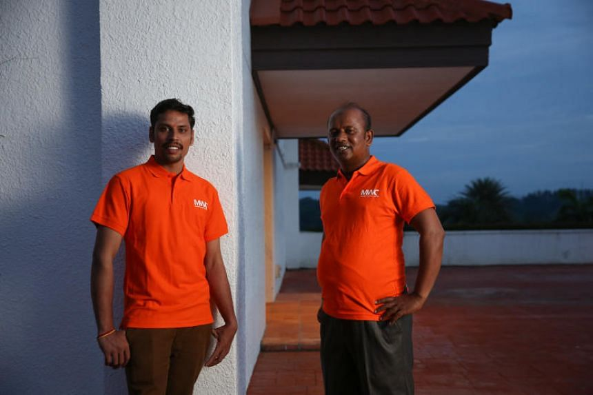 Construction worker Govindasami Venkatesan and safety coordinator H.A. Saeed Abdul Hai Hauladar. Mr Govindasami and 19 other volunteers were awarded for their work in reaching out to their peers to help address issues like salary disputes.