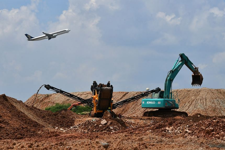 A machine sieving soil to ensure that the right quality of soil goes into the construction of taxiways. The Changi East project, which includes Terminal 5, is Singapore's most ambitious attempt, since Changi Airport opened on July 1, 1981, to cemen