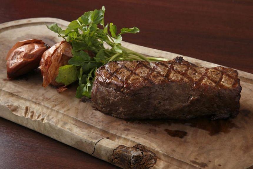 Wakanui Grill Dining restuarant 's The Ocean beef bone-in ribeye.