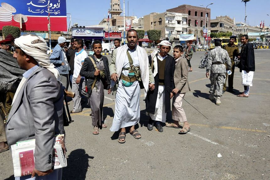 Houthi followers gather at a square a day after fighting broke out between Houthi rebels and the forces loyal to Yemen's ex-president Ali Abdullah Saleh.