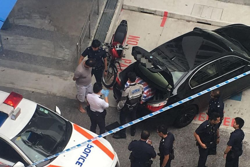 The car chase ended at Block 335, Woodlands Street 32, on Dec 3, 2017. A 35-year-old man was arrested and a 31-year-old traffic police officer was injured in the pursuit.