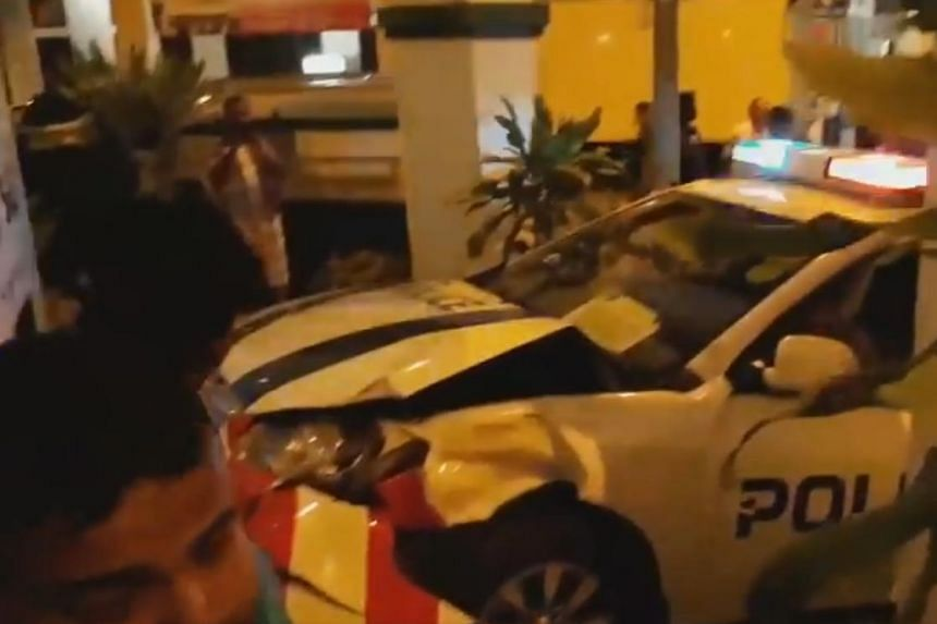 A video of the accident's aftermath shows a heavily damaged police car which had mounted a kerb.