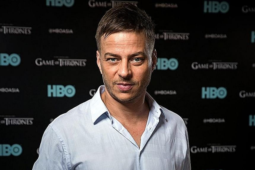German actor Tom Wlaschiha (above) as the mysterious Jaqen H'ghar (left) in Game Of Thrones.