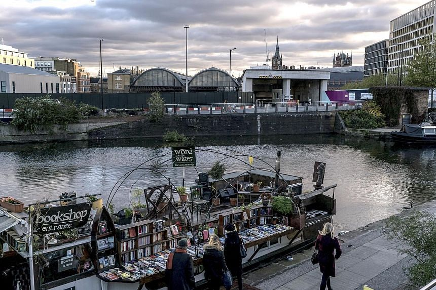 The Word On The Water bookstore (left) is on a 15m-long boat now moored on the Regent's Canal (above), around the corner from the British Library in London.