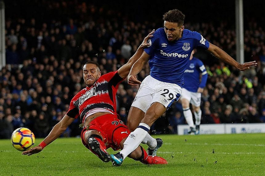 Everton's Dominic Calvert-Lewin scores their second goal in the 2-0 win against Huddersfield Town on Saturday. It was Sam Allardyce's first match in charge of the Toffees.