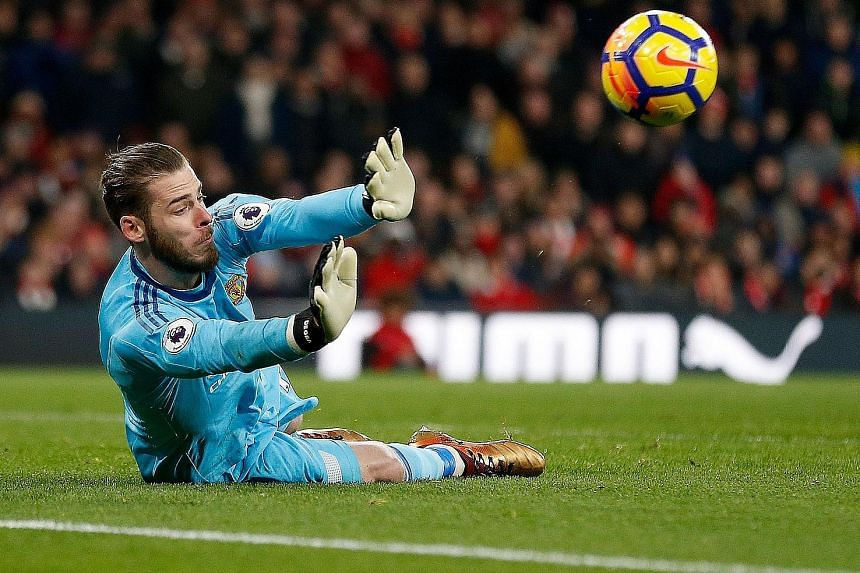 David de Gea dives to his right to deny Arsenal's Sead Kolasinac - one of his 14 saves against the Gunners. The Spanish goalkeeper's imperious showing was a major factor in Manchester United's 3-1 victory.