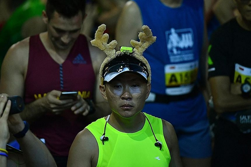 Left: One runner gets into the Christmas spirit a little earlier this year. Right: Another runner prepares for a well-earned body rub having completed his race exertions. Above: A gentleman who came dressed for the occasion, Nguyen Som Nam completed