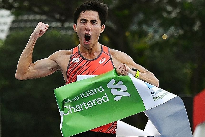 Soh Rui Yong finishing the Standard Chartered Singapore Marathon yesterday. He was the top Singaporean, with a time of 2:35:55 in the event, which was also the official National Championships race this year.