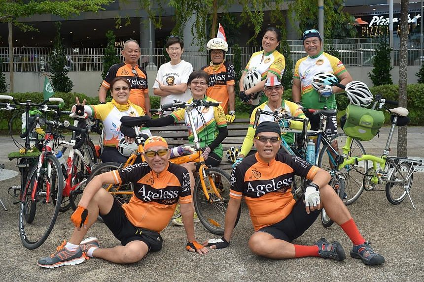 Above: (front row, from left) Ageless Bicyclists' Mr Malcolm Chen, 72, with volunteers Ivan Lim, 55, (second row, from left) Patsy Lim, 63, Lee Geok Yian, 62, John Cheng, 80, (back row, from left) David Leong, 64, Justine Sim, 45, K.C. Au Yeong, 66,
