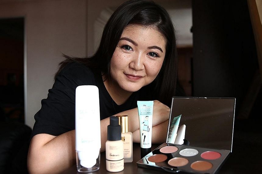 University student Jean Lee with some of the items she bought during Black Friday sales last month. The 21-year-old spent over $300 on clothes and make-up