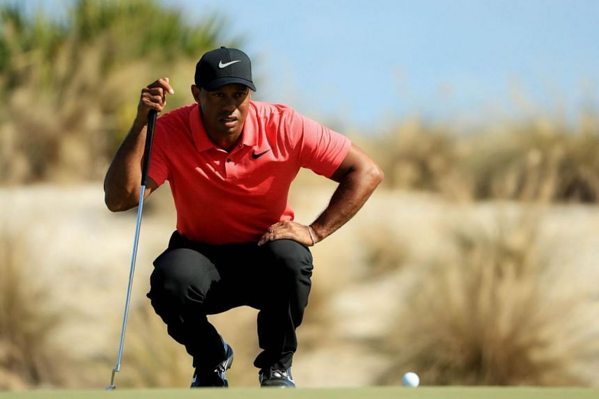 Tiger Woods lines up a putt on the second green during the final round of the Hero World Challenge in Nassau, Bahamas on Dec 3, 2017.
