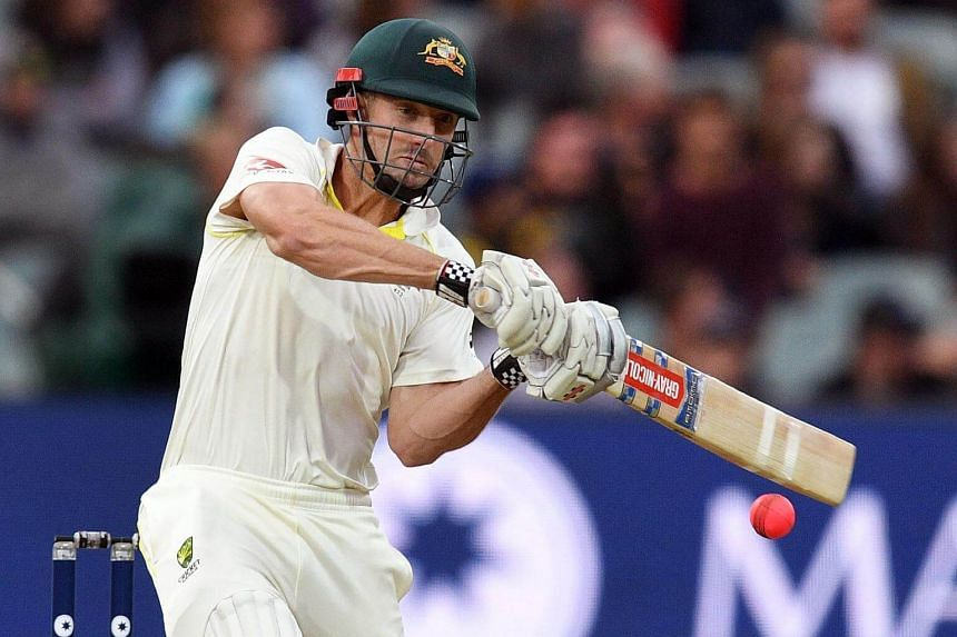 Australia's batsman Shaun Marsh hits the ball to the boundary from the England bowling on the second day of the second Ashes cricket Test match in Adelaide.