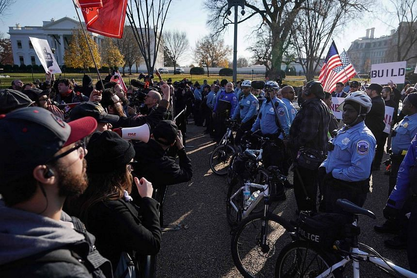 Counter-protesters shout slogans at white nationalists who were rallying behind a line of police on Pennsylvania Avenue in front of the White House in Washington, on Dec 3.