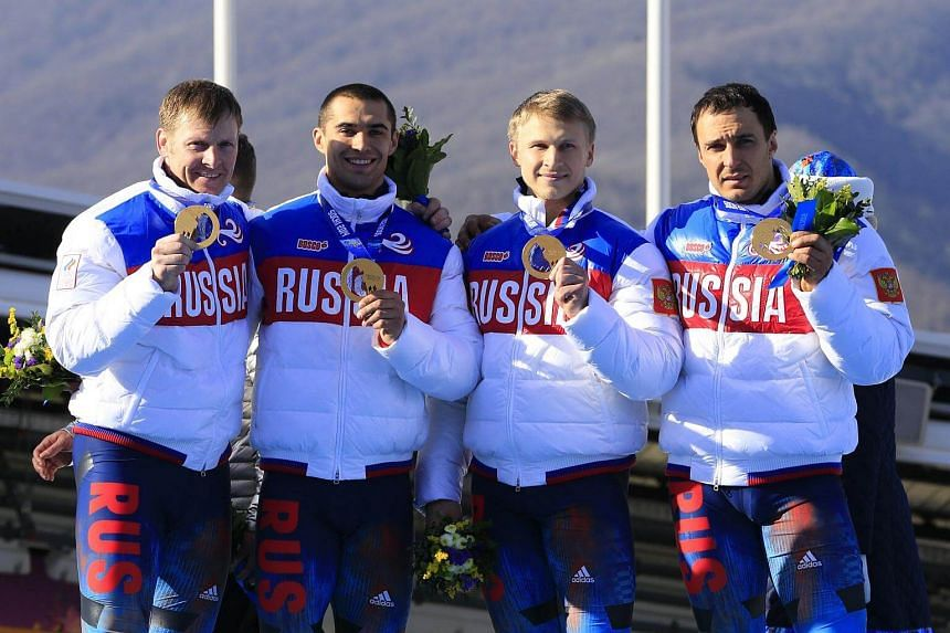 Among those named and shamed for drug-taking last month was Russia's flag carrier at the Games, Alexander Zubkov (left), who was stripped of his four- and two-man bobsleigh titles.