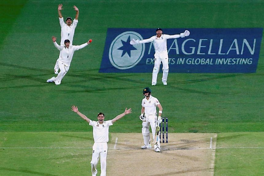 England's Chris Woakes appeals successfully for lbw to dismiss Australia's captain Steve Smith during the third day of the second Ashes cricket test match.