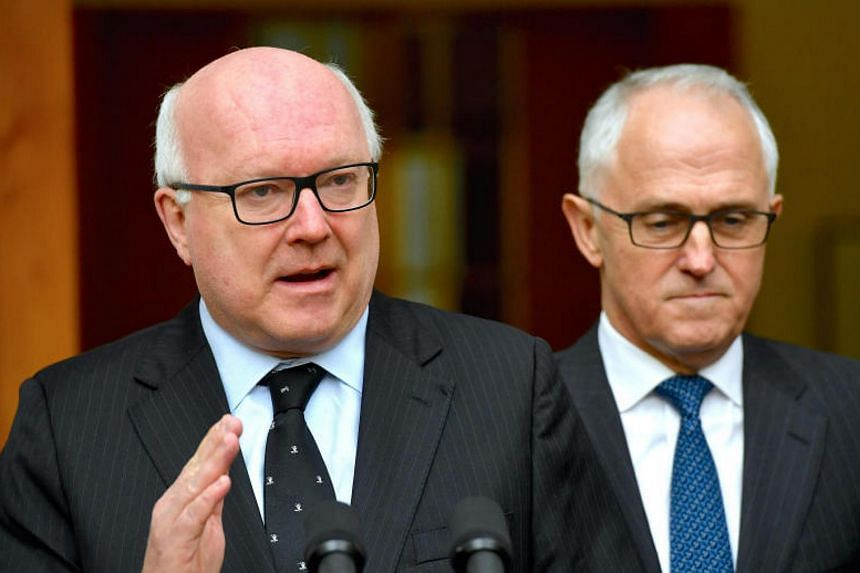 Australia's Attorney-General George Brandis (left) and Prime Minister Malcolm Turnbull speak during a media conference at Parliament House in Canberra, Australia on July 18, 2017.