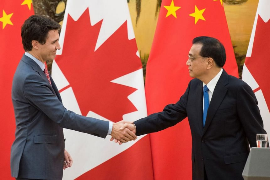 Canadian Prime Minister Justin Trudeau (left) and Chinese Premier Li Keqiang signed three trade agreements at the Great Hall of the People in Beijing on Dec 4, 2017.