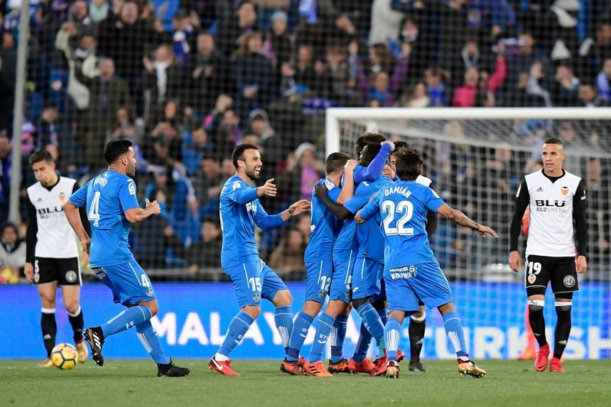 Getafe's players celebrating after midfielder Markel Bergara scored against Valencia, during their La Liga match on Dec 3, 2017.
