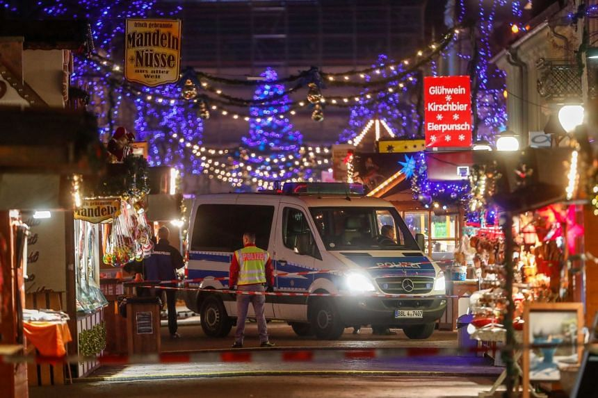 Police officers standing guard at an empty Christmas market after it was evacuated by police, after an explosive device was found, in Potsdam, Germany, on Dec 1, 2017.