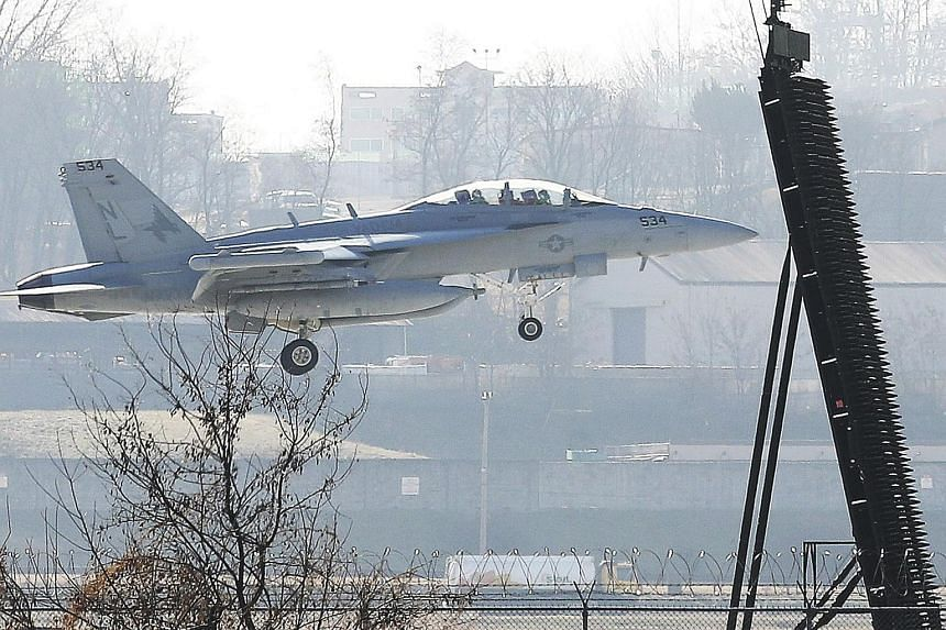 An EA-18G Growler electronic attack aircraft landing at the US Osan Air Base in Pyeongtaek, after North Korea launched a suspected ICBM, on Nov 29, 2017.