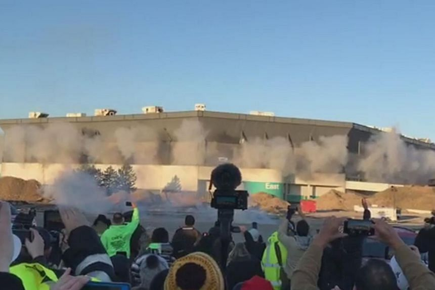 Smoke exploding out of the Silverdome during a demolition attempt on Dec 3, 2017. The stadium remained standing, which demolition officials said could have been because about 10 per cent of the charges failed to detonate.