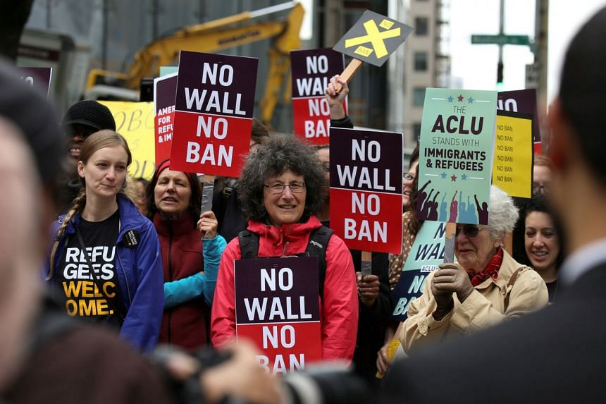 People protesting against US President Donald Trump's travel ban in Seattle on May 15, 2017. Federal appeals courts are set to hear arguments on the legality of the ban.