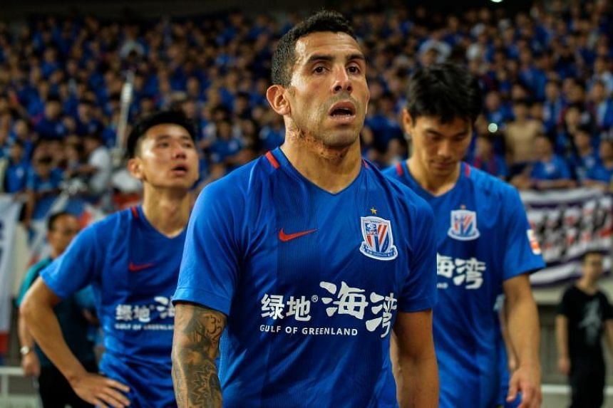 Carlos Tevez (front) has struggled in his time with Shanghai Shenhua so far, and the 33-year-old has become a symbol of Chinese clubs' largesse that the Beijing government hopes will never be repeated.