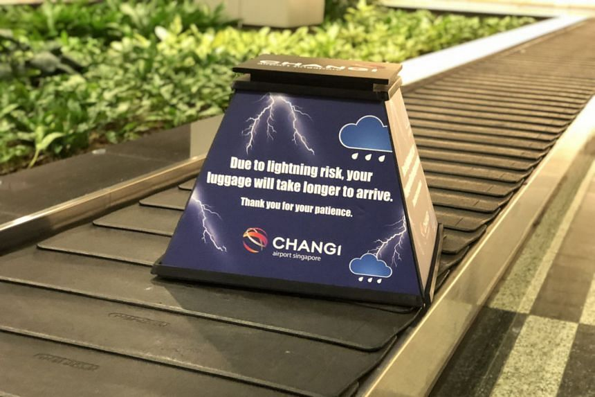 During rainy weather, ground handlers at Changi Airport may temporarily stop retrieving baggage from the aircraft, because there is no shelter where they work and it is a lightning-risk area.