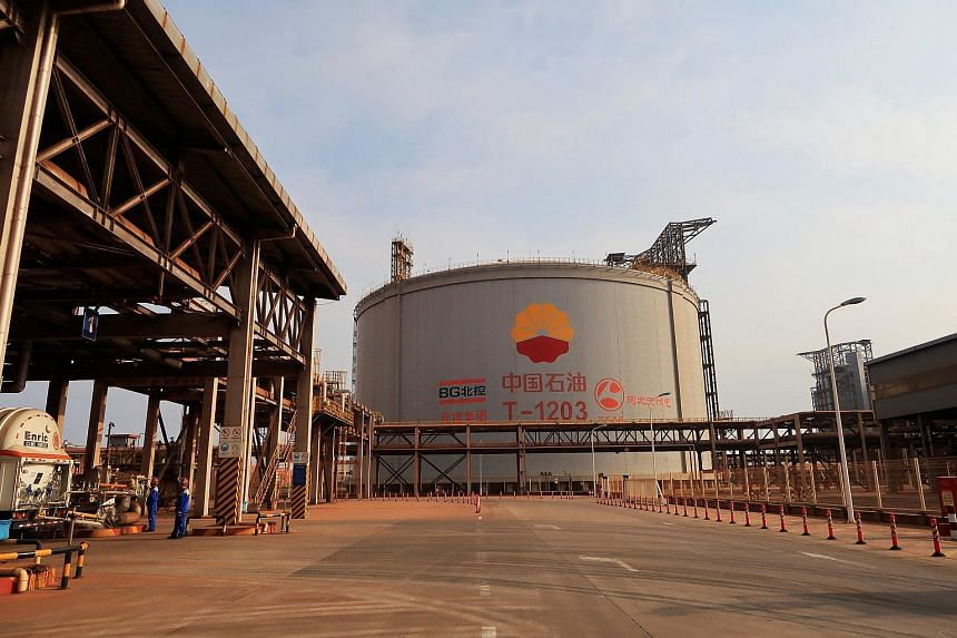 A liquefied natural gas storage tank is seen at Caofeidian terminal, in Tangshan, Hebei province, China.