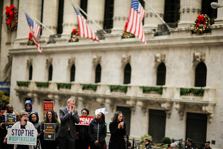 NYC Mayor Bill de Blasio joins demonstrators as they take part in a protest against government's tax reforms, on Dec 2.